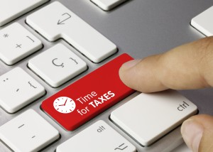Time for taxes keyboard key. Finger